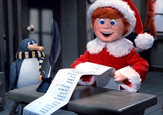 """santa.88--SANTA CLAUS IS COMIN' TO TOWN-- Fred Astaire narrates this tale of Kris Kringle (voiced by Mickey Rooney), a young boy with an immense desire to do good things for others, and eventually earns the name of Saint Claus, or Santa Claus. ABC Family presents this timeless animated special as part of it's annual """"25 Days of Christmas"""" programming event. ( WARNER BROS)"""
